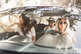 Group of friends travelling in luxury car