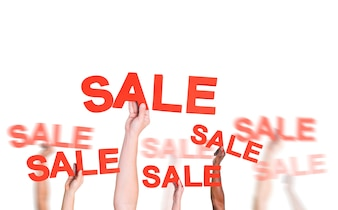 Group of Hands Holding the Word  Sale  for Promotion