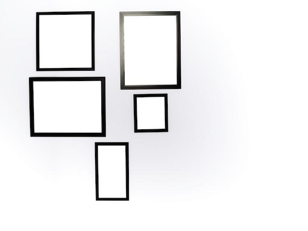 모형 사진 프레임 그룹입니다. 흰색 벽 배경에 복사 공간이 있는 검정 프레임 모형이 있는 흰색 사각형 그림.