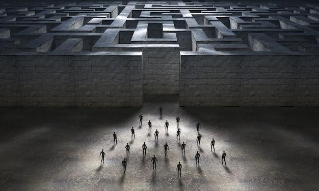 大きな迷路の入り口に向かう人々のグループ