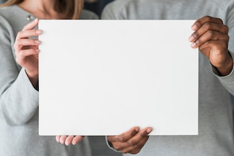Group of people holding blank paper template