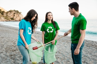 Group of volunteers collecting waste at the beach