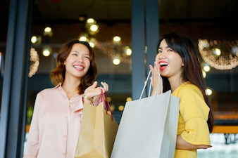 Group of women hand holding ecology shopping bag