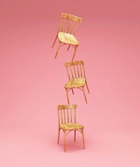 ピンクのスタジオの背景に木製の椅子のグループ