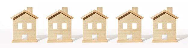白い背景の上の木造住宅モデルのグループ