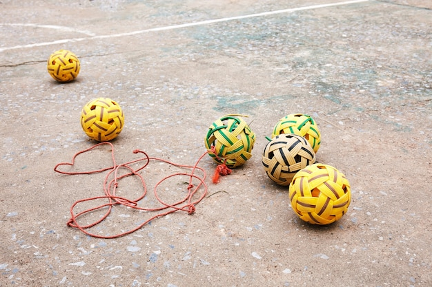 Group of old sepak takraw on the concrete floor