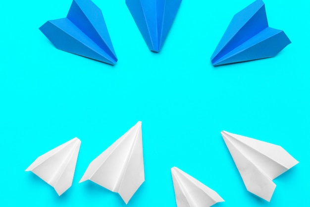 Group of paper planes on blue background. business for new ideas creativity and innovative solution concepts