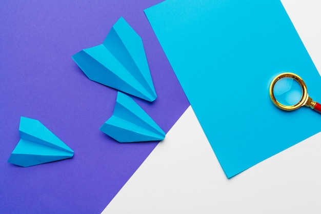 Group of paper planes on blue. business for new ideas creativity and innovative solution concepts