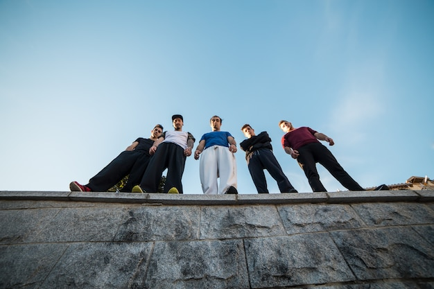Group of parkour professionals standing and posing