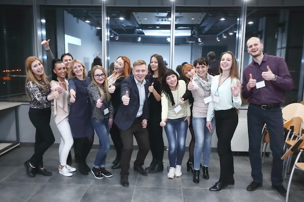 Group of participants of the seminar showing thumb up.concept of education