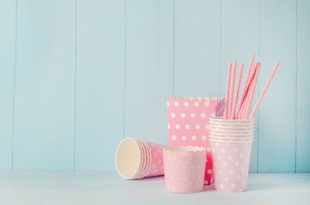 Group of party supplies on blue wooden table