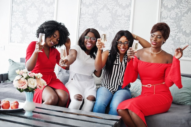 Group of partying girls clinking glasses with sparkling wine champagne