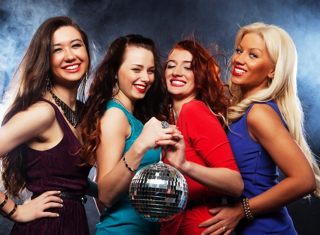 Group of partying girls with disco ball, happy and smile