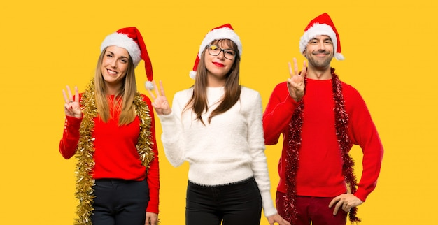 A group of people blonde woman dressed up for christmas holidays happy and counting three