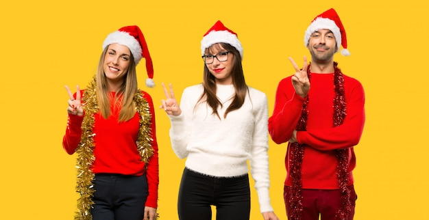 A group of people blonde woman dressed up for christmas holidays happy and counting two