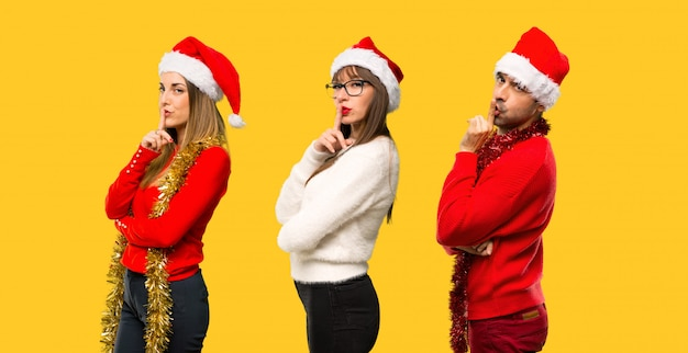 A group of people blonde woman dressed up for christmas holidays showing a sign of closing
