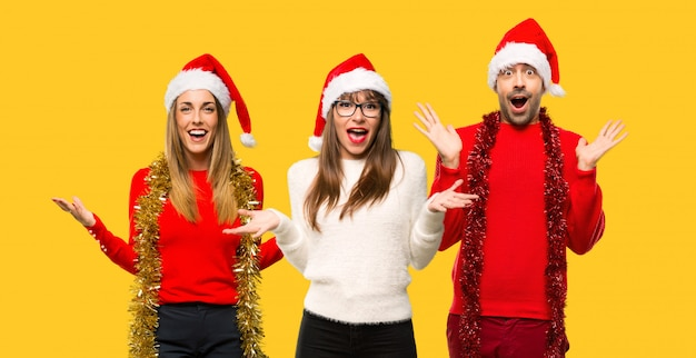 A group of people blonde woman dressed up for christmas holidays with surprise expression