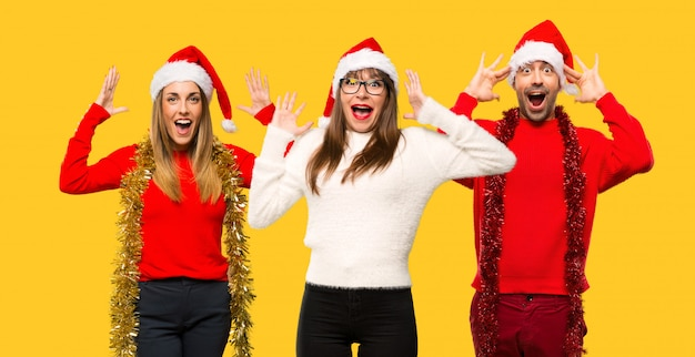 A group of people blonde woman dressed up for christmas holidays with surprise