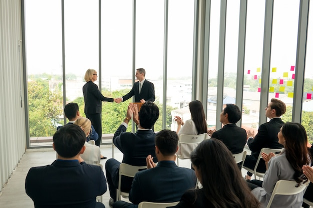 Group of people in business corporate event training seminar, the conferences event or training education. business workplace management and development performance.