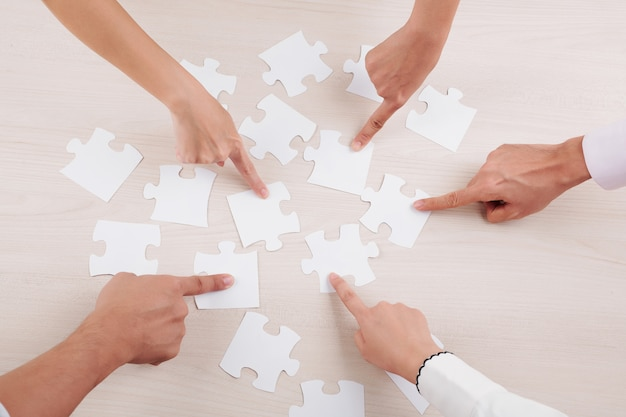 Group of people collecting puzzles