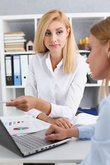Group of people deliberate on white laptop problem in office portrait. graph consult, idea participate, creative talk, review situation job, client document explain, train, successful decision concept