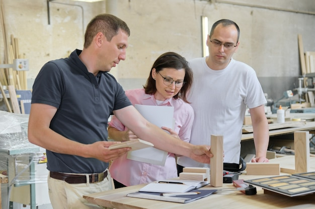 Group of people designer, client, carpenter, engineer choosing wooden products