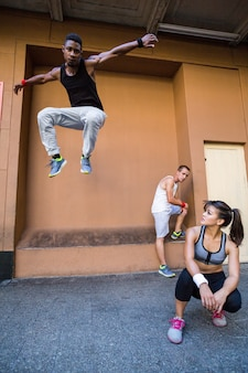 Group of people doing parkour in the city