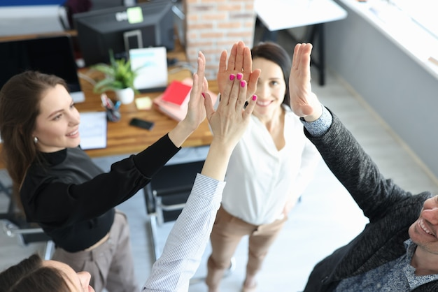 Group of people giving five at business seminar closeup