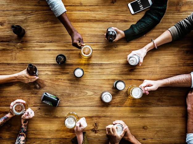 Group of people having party with beer together in aerial view