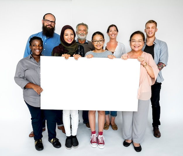 Group of people holding a banner