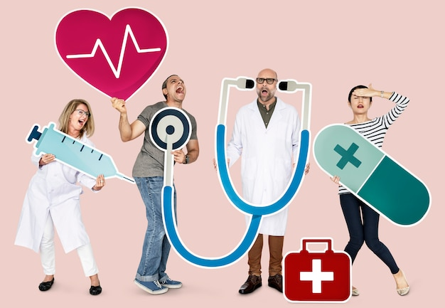 Group of people holding health care icons