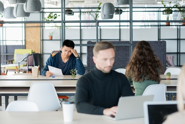 Group of people in open space office