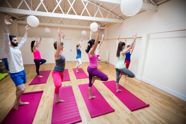 Group of people performing gyan mudra yoga exercise