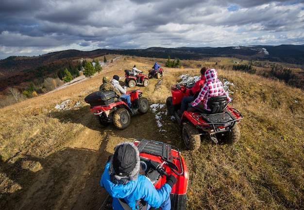 Group of people riding off-road vehicles