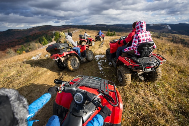 Group of people riding quad bikes