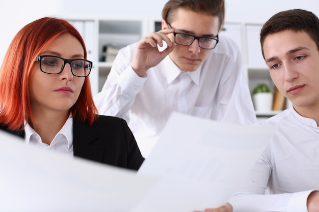 Group people sit in office deliberate on problem