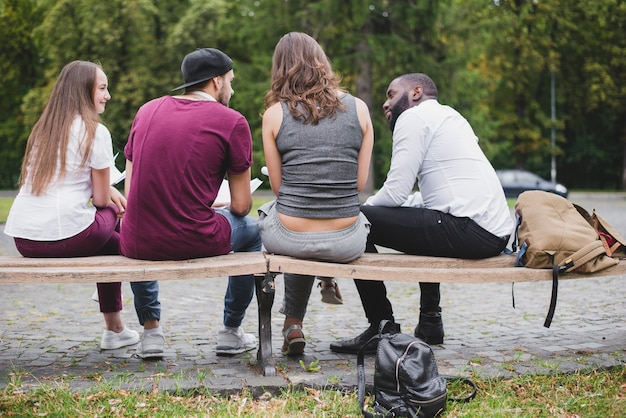 Group of people sitting on bench outside