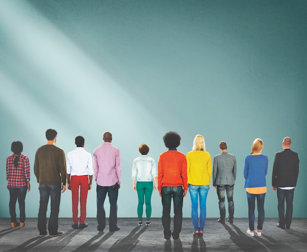 Group of people standing rear view concept