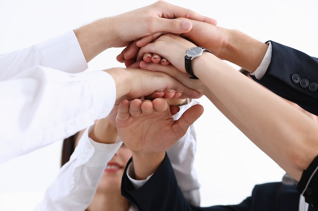 Group of people in suits crossed hands