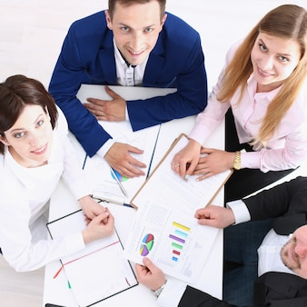 Group of people in suits working