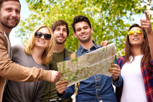 Group of people using a map to look a destination