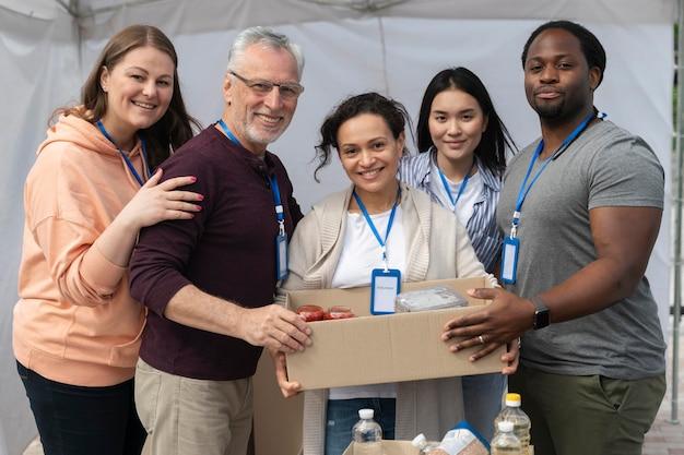 Group of people volunteering at a foodbank for poor people