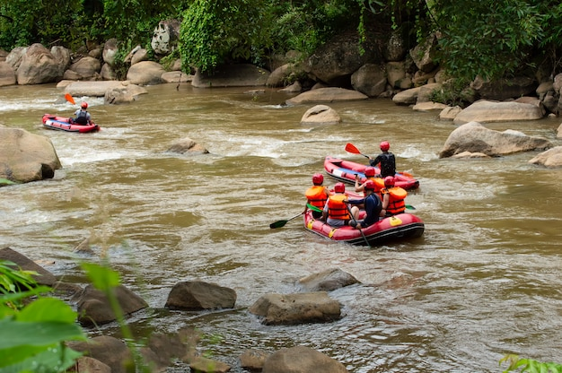 Group of people white water rafting on the rapids of maetaman mae taeng river