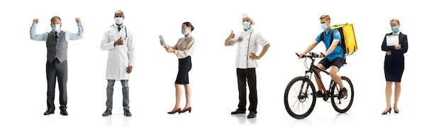 Group of people with different professions on white studio wall