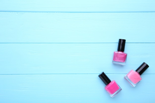 Group of pink nail polishes on blue background