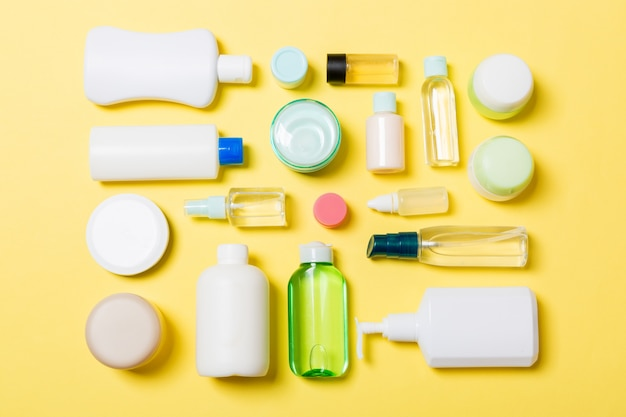 Group of plastic bodycare bottle flat lay composition with cosmetic products
