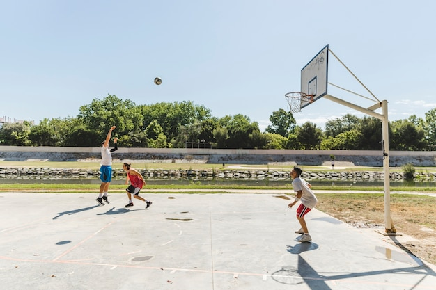 Group of player playing basketball at outdoors court