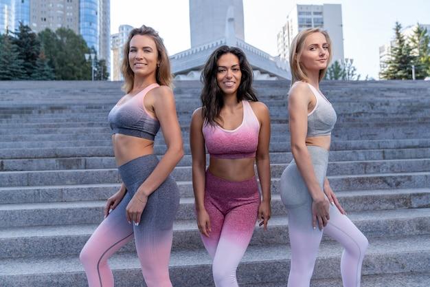 Group portrait of women dressed in sportswear in the summer on the street