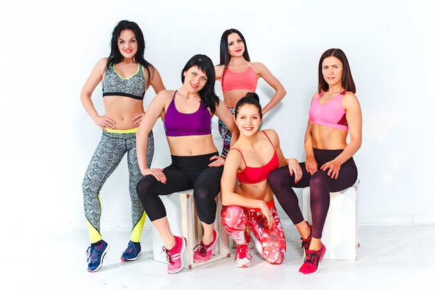Group posing in a gym of a fitness center
