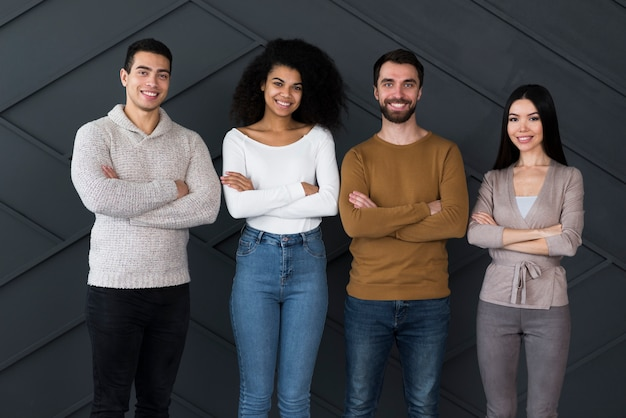 Group of positive young people posing together